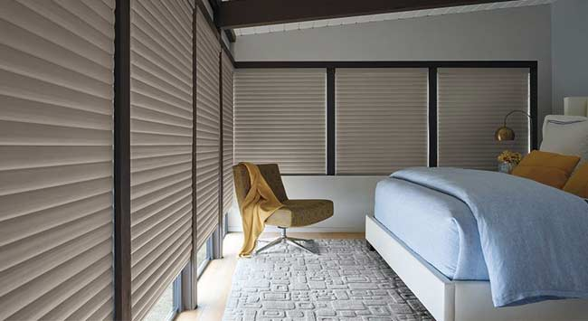 Zonwering voor de slaapkamer tegen warmte van buiten